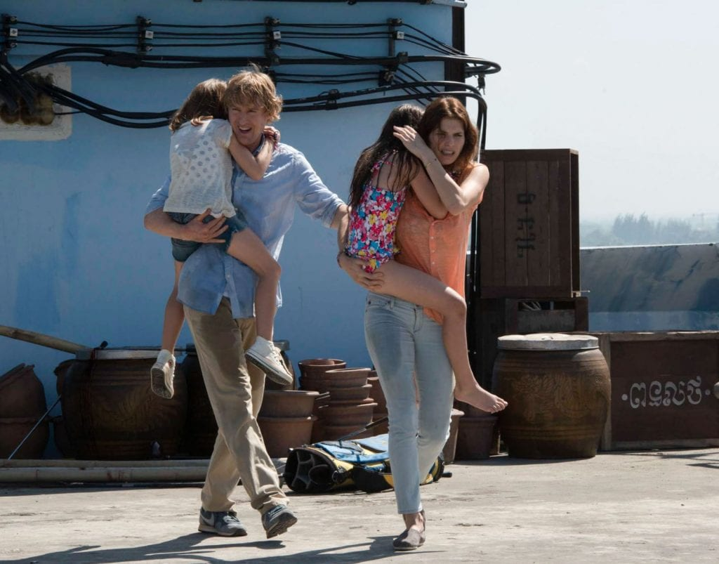 """In this image released by The Weinstein Company, Owen Wilson, left, and Lake Bell appear in a scene from, """"No Escape."""" (Roland Neveu/The Weinstein Company via AP)"""